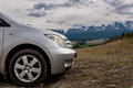 Car mountains snowy peaks in a picturesque location with view the hills and covered by forests and snow capped on the horizon Stock Image