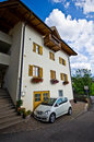 Car parked at tirol house a private in front of a typical castelrotto italy Stock Image