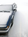 Car in parking lot covered in fresh snow detail of during winter storm Stock Photography
