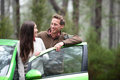 Car people happy couple driving on road trip in green new rental in beautiful nature forest romantic multiracial the Stock Photography