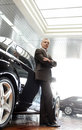 This car is perfect for me confident senior businessman leaning on his new he choosed at the dealership Royalty Free Stock Image