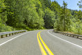 A car perspective driving on a paved road at high elevations in Royalty Free Stock Photo