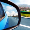 Car rearview mirror and highways from the inside to see the highway cars Royalty Free Stock Photography