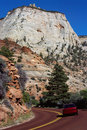 Car on the red road of Zion Park, USA Royalty Free Stock Photo