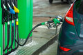 Car refueling on a petrol station in winter close up Royalty Free Stock Photo