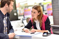 Car rental assistant informing client Royalty Free Stock Photo