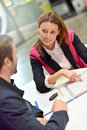 Car rental saleswoman informing client Royalty Free Stock Photo