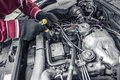 Car repair under the hood of the car toned photo Royalty Free Stock Image