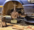 Car repair wheel old and leak oil Royalty Free Stock Images