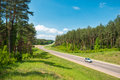 Car on road in forest. Belarus. Royalty Free Stock Photo