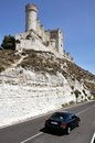 Car on the road near the Penafiel Castle Stock Images