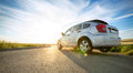 Car on road over sunny day Royalty Free Stock Photo