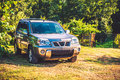 Car road suv in green countryside field Royalty Free Stock Photography