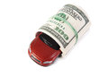Car in roll of dollars on white background Stock Photo