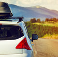 Car with a roof rack for traveling on mountain road Stock Photos