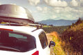Car with a roof rack for traveling on mountain road Royalty Free Stock Image