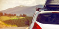 Car with a roof rack for traveling on mountain road Royalty Free Stock Photo