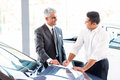 Car salesman sale senior just made a to young customer Royalty Free Stock Photo