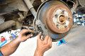 Car service forward activity automotive worker change the brakes Stock Photos