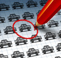 Car shopping concept and auto insurance search symbol with a red pencil crayon highlighting a drawing from a group of cars as an Stock Photo