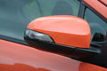Car side mirror in a close up orange color Royalty Free Stock Photos