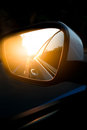 Car side view mirror on the road Royalty Free Stock Photo