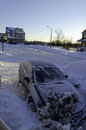 Car after snowstorm in canadian town Stock Image