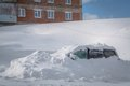 Car stuck in heavy snowbank the winter Stock Images