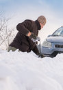 Car stuck in snow man digging up Royalty Free Stock Photo
