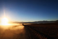 Car at sunrise lonely altiplano bolivia Stock Photo