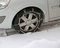 Car tire with snow chains in winter Royalty Free Stock Photo