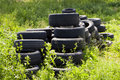 Car tires pollute the environment. Stock Image
