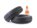 Car tires and road cone two winter tyres shot on white Royalty Free Stock Photos