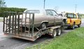 Car Towed On A Flatbed Truck