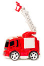 Car toy red fire truck with extendable ladder and basket, Royalty Free Stock Photo