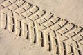Car tracks tyre in the sand beach wd background Royalty Free Stock Photos