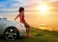 Car travel and freedom female driver enjoying beautiful sunshine over the sea after driving to coast in summer vacation woman Royalty Free Stock Images