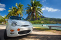 Car trip around tropical island beaches on sunny day Stock Images