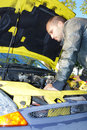 Car trouble man has and looks at the engine Stock Photography