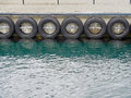 Car tyre pier bumpers Royalty Free Stock Photo