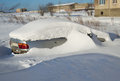 Car under snow on parking in a court yard Royalty Free Stock Photo