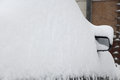 Car under a snowbank at the winter Royalty Free Stock Photo