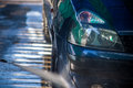 Car Wash Closeup. Washing Car by High Pressure Water Royalty Free Stock Photo
