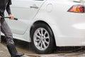 Car washing using high pressure water jet. Royalty Free Stock Photo