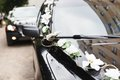 The car in wedding cortege decorated with flowers Stock Photo