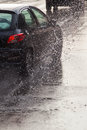 Car on a wet street at heavy rain Royalty Free Stock Photo