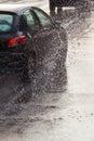 Car on a wet street at heavy rain Royalty Free Stock Photo