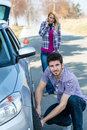 Car wheel defect man change puncture tire Royalty Free Stock Photos