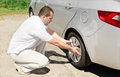 Car wheel defect man change puncture tire outdoors Royalty Free Stock Image