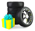 Car wheels with big gift box white background Royalty Free Stock Image